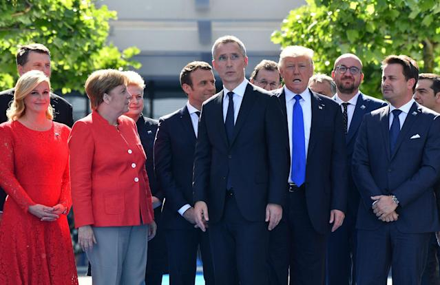 <p>President Donald Trump, third right, NATO Secretary General Jens Stoltenberg, center, and German Chancellor Angela Merkel walk through NATO headquarters at the NATO summit in Brussels on Thursday, May 25, 2017. US President Donald Trump and other NATO heads of state and government on Thursday will inaugurate the new headquarters as well as participating in an official working dinner. (AP Photo/Geert Vanden Wijngaert) </p>