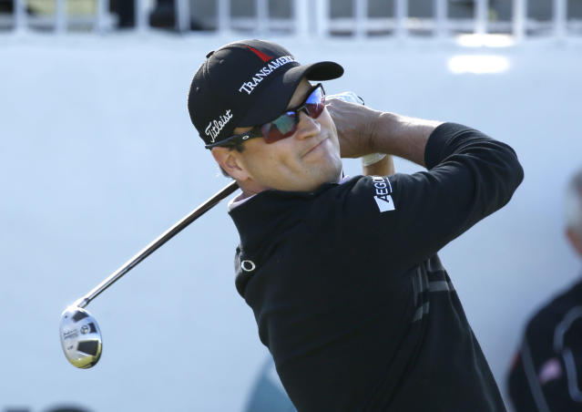 Zach Johnson watches his tee shot on the first hole during the final round of the BMW Championship golf tournament at Conway Farms Golf Club in Lake Forest, Ill., Monday, Sept. 16, 2013. (AP Photo/Charles Rex Arbogast)