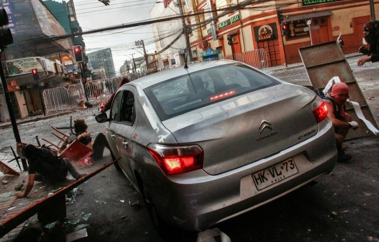 A car runs over demonstrators protesting against the government of Sebastian Pinera in Antofagasta, Chile on November 21, 2019