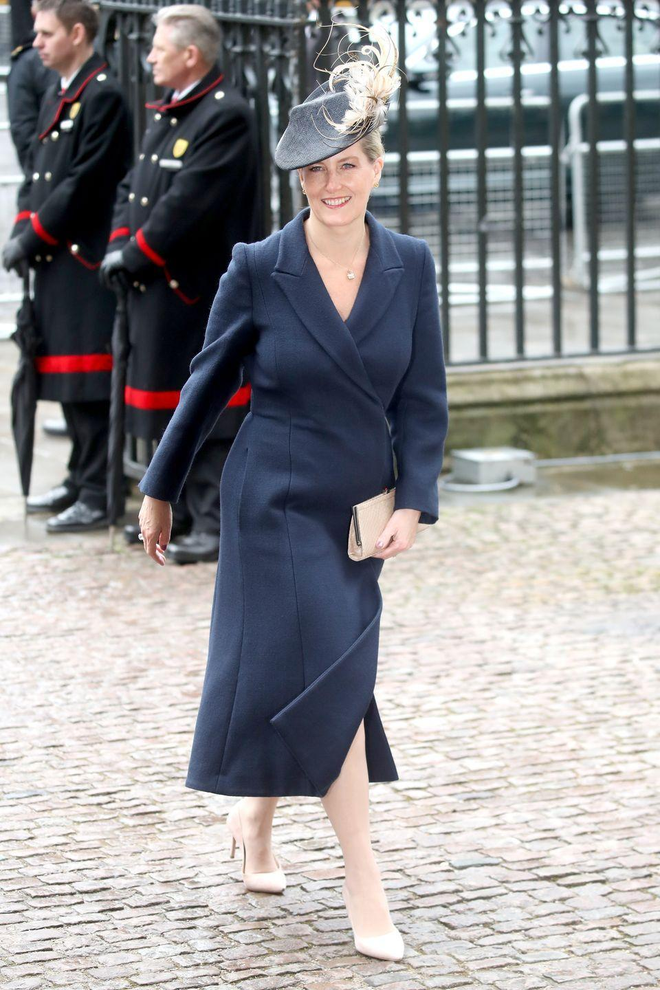 """<p>For this year's Commonwealth Day Service, the entire royal family was quite <a href=""""https://www.townandcountrymag.com/society/tradition/g19405600/royal-family-commonwealth-day-celebration/?slide=2"""" rel=""""nofollow noopener"""" target=""""_blank"""" data-ylk=""""slk:color-coordinated, all wearing blue and white"""" class=""""link rapid-noclick-resp"""">color-coordinated, all wearing blue and white</a> (aside from the Queen, that is). Here's how Sophie, Countess of Wessex styled her navy ensemble. </p>"""