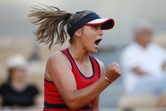FILE - In this June 1, 2019, file photo, Sofia Kenin, of the United States, clenches her fist after scoring a point against compatriot Serena Williams in the last game of the second set during their third round match of the French Open tennis tournament at the Roland Garros stadium in Paris. Kenin, who is 20, stunned Serena Williams at the French Open this year and now is ranked a career-best No. 20. She is one of a group of promising young Americans in tennis playing in the U.S. Open, which starts next week. (AP Photo/Christophe Ena, File)