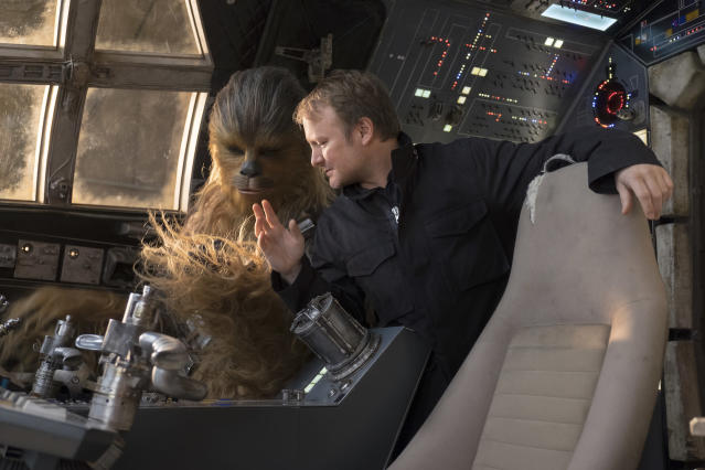 Chewbacca gets some Millennium Falcon-flying tips from director Rian Johnson. (Photo: Lucasfilm)