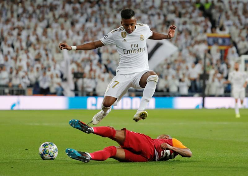 Soccer Football - Champions League - Group A - Real Madrid v Galatasaray - Santiago Bernabeu, Madrid, Spain - November 6, 2019 Real Madrid's Rodrygo in action with Galatasaray's Mariano REUTERS/Susana Vera