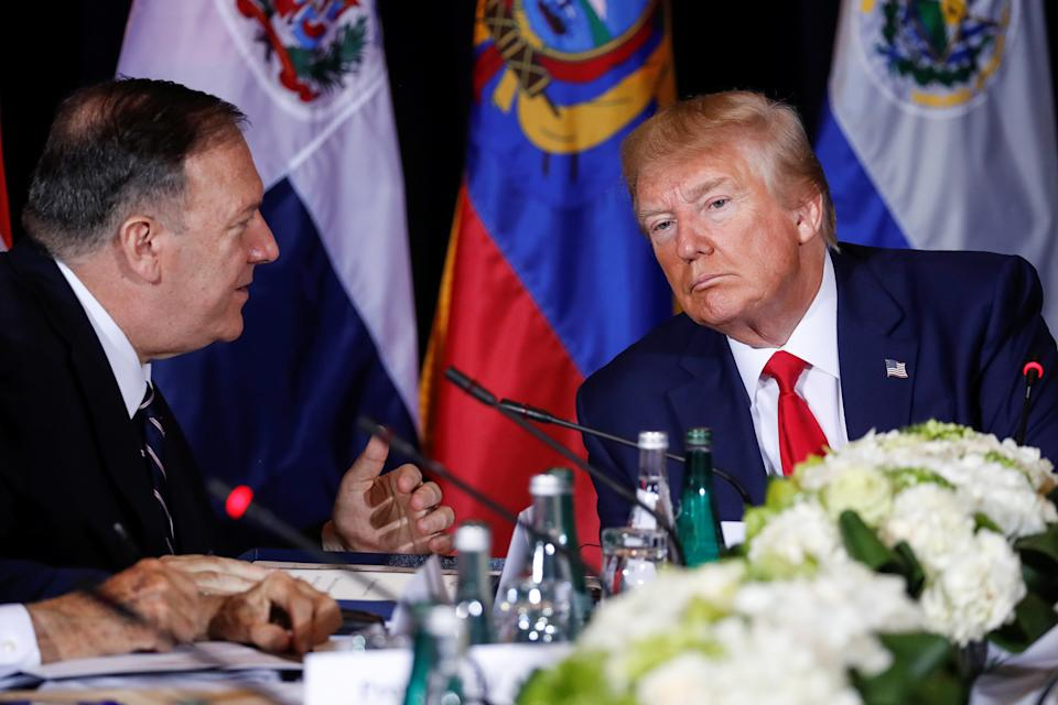 U.S. President Donald Trump confers with U.S. Secretary of State Mike Pompeo during a multilateral meeting with Western Hemisphere leaders about Venezuela during the 74th session of the United Nations General Assembly (UNGA) at U.N. headquarters in New York City, New York, U.S., September 25, 2019.  REUTERS/Jonathan Ernst