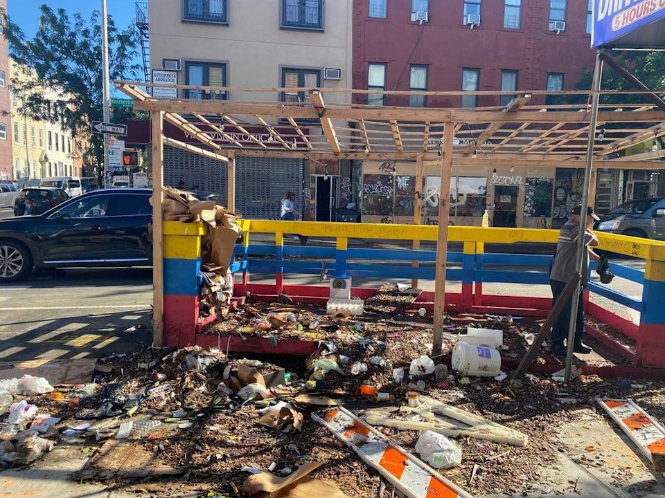An outdoor dining area at Ecuadorian eatery, El Encebollado de Victor, in Brooklyn, New York was overwhelmed with debris following torrential rain and winds from Ida (Alex Woodward/The Independent)