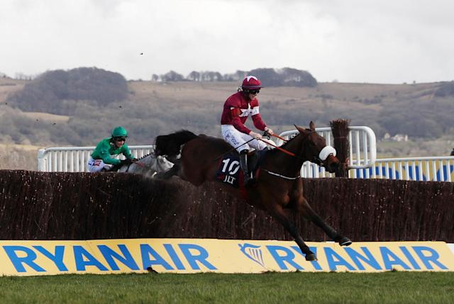 Horse Racing - Cheltenham Festival - Cheltenham Racecourse, Cheltenham, Britain - March 15, 2018 Shattered Love ridden by Jack Kennedy before winning the 13:30 JLT Novices' Chase Action Images via Reuters/Matthew Childs