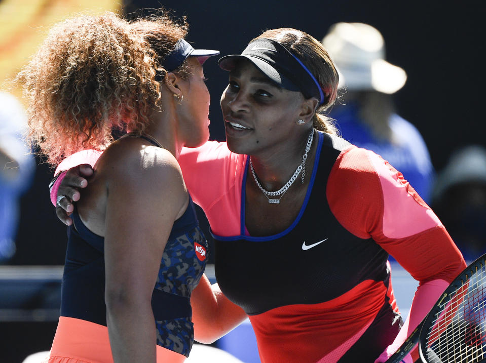 Japan's Naomi Osaka, left, is congratulated by United States' Serena Williams after winning their semifinal match at the Australian Open tennis championship in Melbourne, Australia, Thursday, Feb. 18, 2021.(AP Photo/Andy Brownbill)
