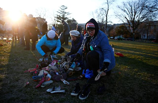 <p>Activists install 7000 shoes on the lawn in front of the U.S. Capitol on Capitol Hill in Washington, March 13, 2018. (Photo: Eric Thayer/Reuters) </p>