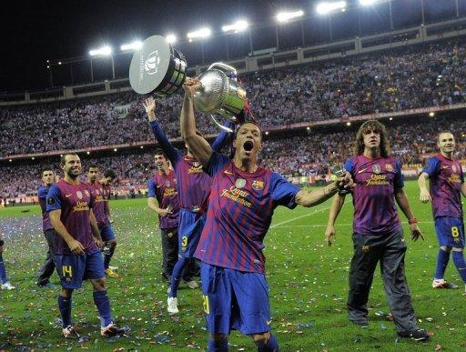 Barcelona's Adriano Correia lifts the Cup as he celebrates his team's Spanish Cup victory