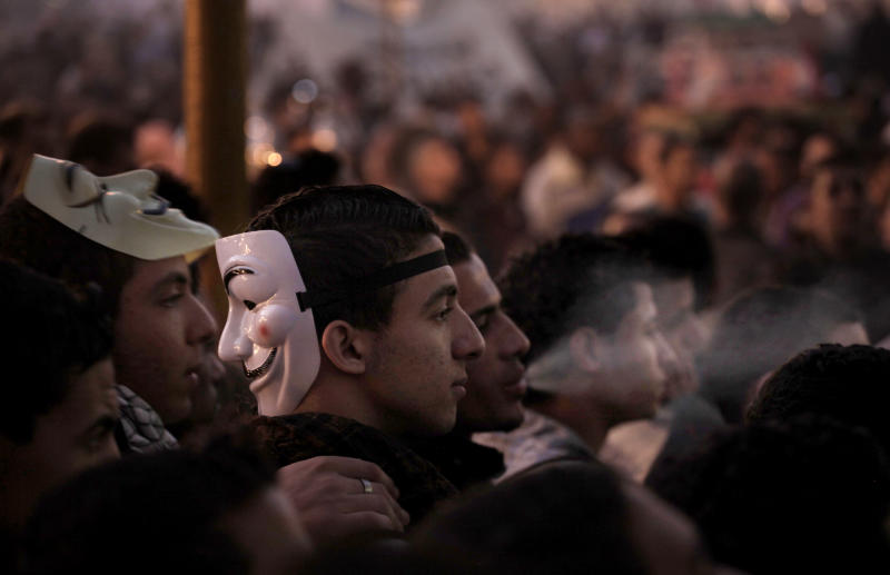 Egyptians attend a demonstration in Tahrir Square, Cairo, Egypt, Friday, Nov. 30, 2012. Liberal and secular parties held major protests against Egyptian President Mohammed Morsi's latest decrees granting himself almost complete powers. (AP Photo/Nariman El-Mofty)