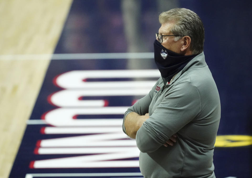 Connecticut head coach Geno Auriemma watches from the sideline during the second half of an NCAA college basketball game against Creighton in Storrs, Conn., Thursday, Dec. 17, 2020. (David Butler II/Pool photo via AP)