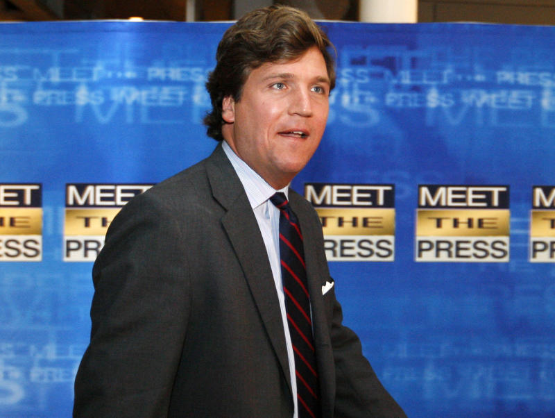 """FILE - In this Nov. 17, 2007 file photo, political commentator Tucker Carlson arrives for the 60th anniversary celebration of NBC's Meet the Press at the Newseum in Washington. Fox News Channel says veteran conservative commentator Tucker Channel will become co-host of the network's weekend morning show, """"Fox & Friends."""" (AP Photo/Charles Dharapak, File)"""