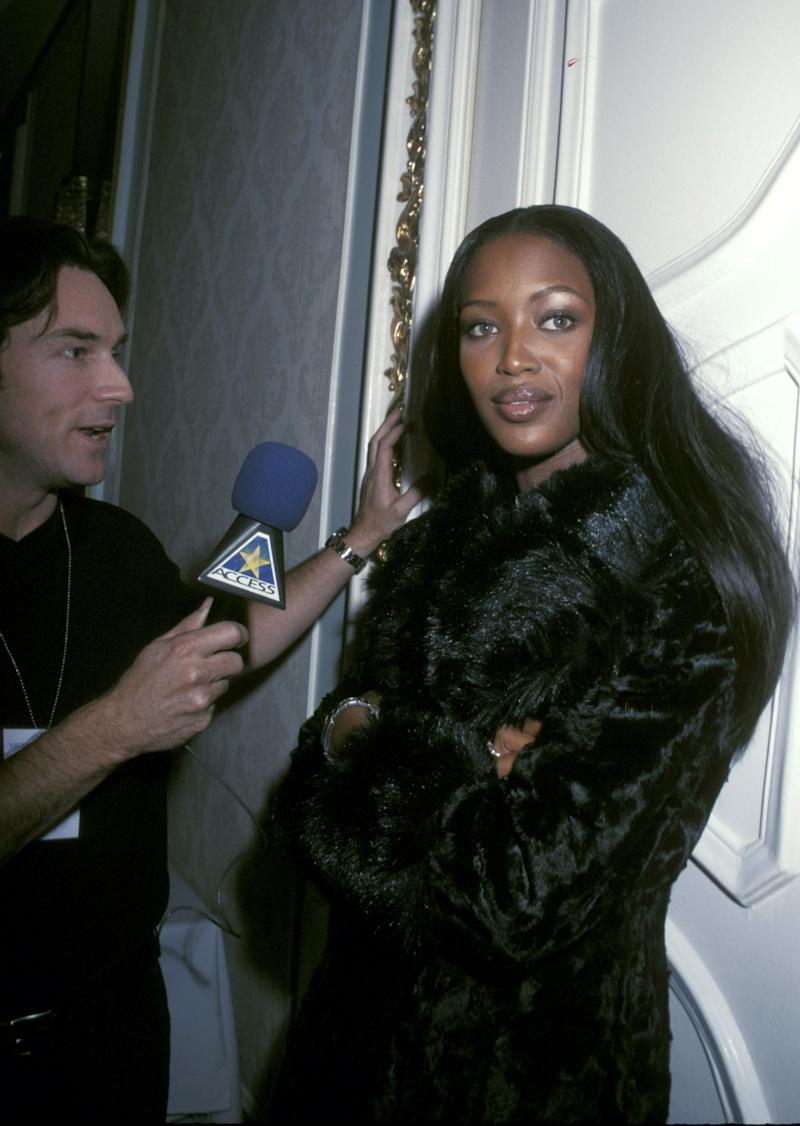 Naomi Campbell backstage at the 1998 Victoria's Secret Pre-Valentine's Day Fashion Show, with Jeff Probst, inside the Plaza Hotel in New York.