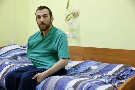A man, according to Ukraine's state security service (SBU) is named Yevgeny Yerofeyev and is one of two Russian servicemen recently detained by Ukrainian forces, speaks during an interview with Reuters at a hospital in Kiev, Ukraine, May 28, 2015. Picture taken May 28, 2015.  REUTERS/Valentyn Ogirenko