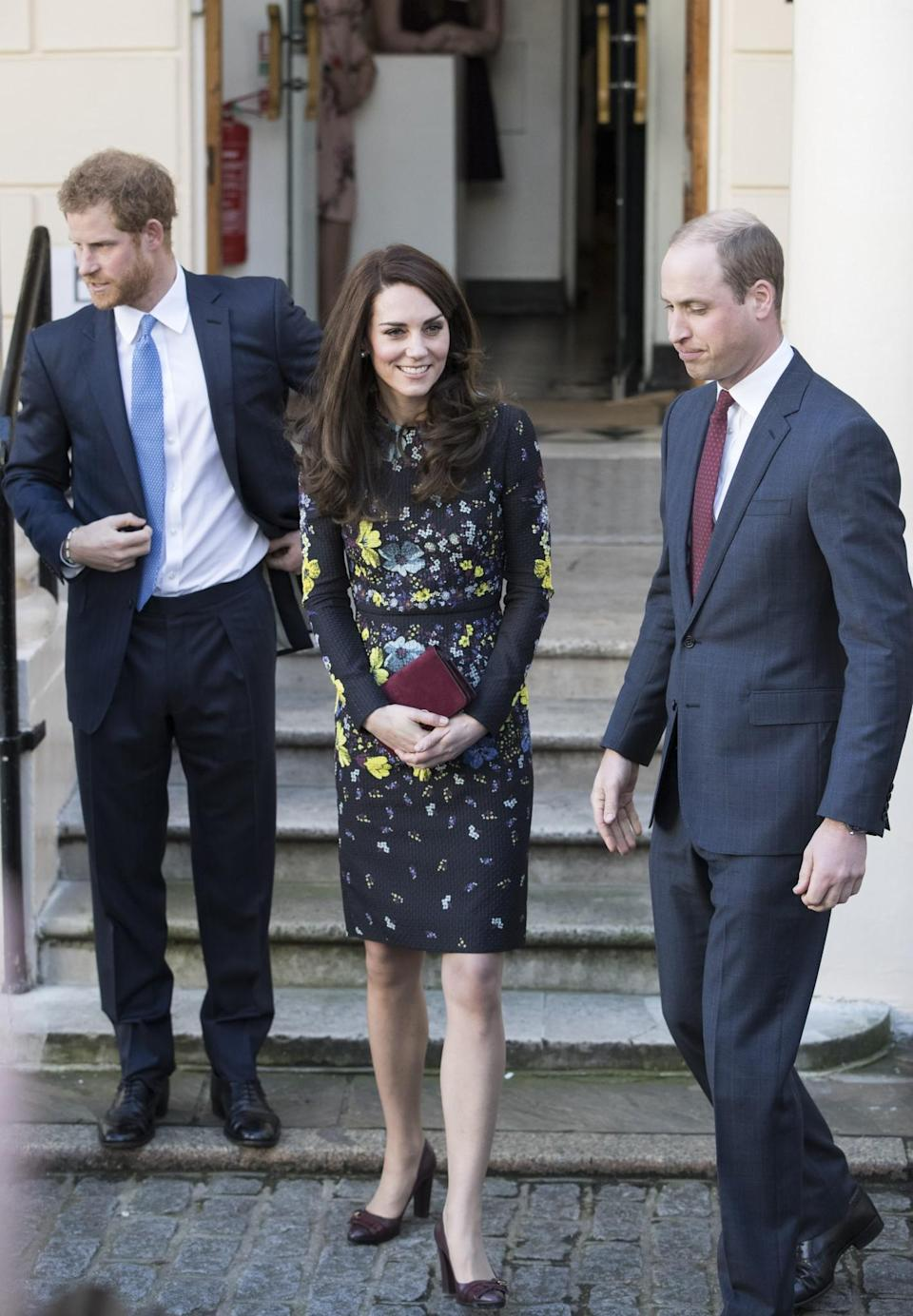 <p>The Duchess appeared perfectly coiffed at the ICA in London, wearing in a dark floral dress by Erdem (costing an eye watering £1050). Appearing in front of the media along with Princes William and Harry to outline her 2017 goals for Heads Together, Kate accessorised with brown buckled pumps and a burgundy suede clutch.<br><i>[Photo: Getty]</i> </p>