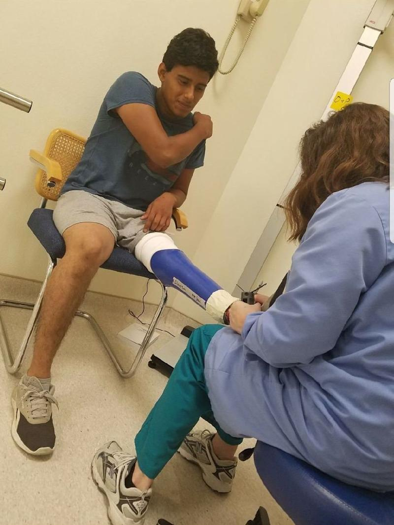 Felipe Abonza-Lopez receives assistance with his prosthetic leg in a photo taken prior to his detention.