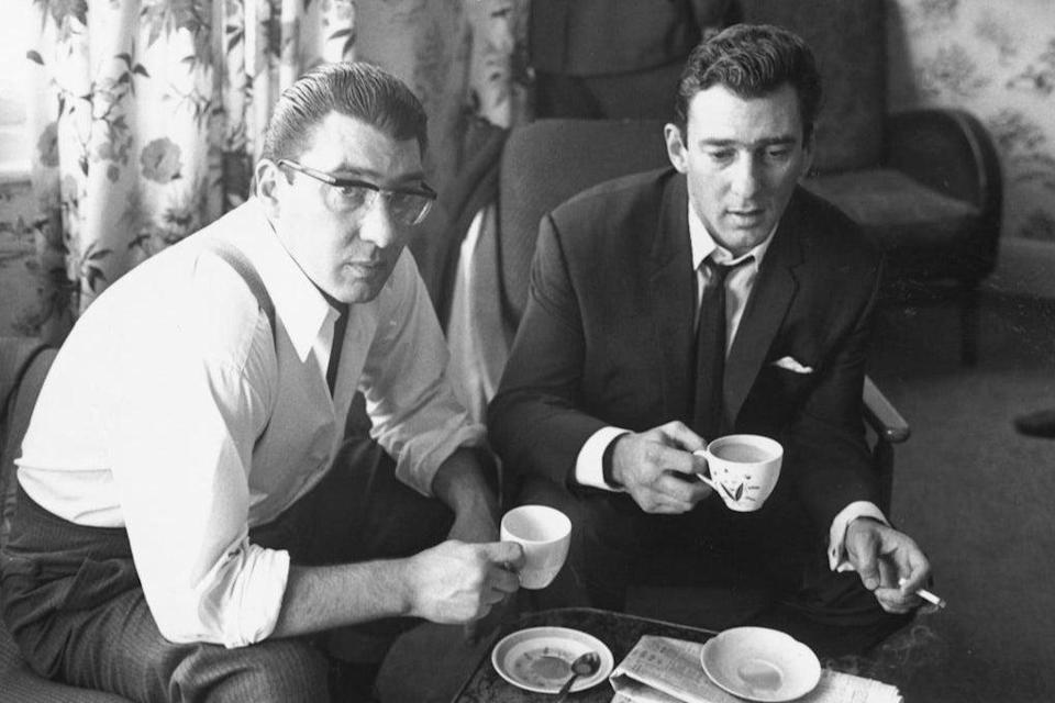 London gangsters Ronnie and Reggie Kray at home having a cup of tea (Photo by William Lovelace/Getty Images)