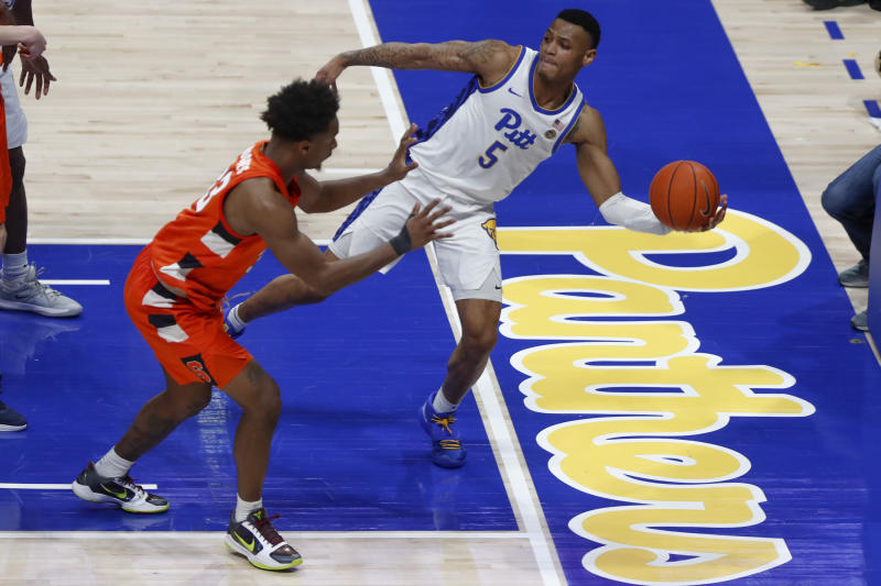 Pittsburgh's Au'Diese Toney (5) saves the ball from going out of bounds as Syracuse's Elijah Hughes defends during the second half of an NCAA college basketball game, Wednesday, Feb. 26, 2020, in Pittsburgh. Syracuse won 72-49.(AP Photo/Keith Srakocic)