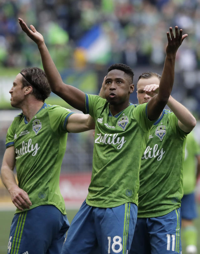 Seattle Sounders' Kelvin Leerdam (18) celebrates after scoring against the Toronto FC, Sunday, Nov. 10, 2019, during the second half of the MLS Cup championship soccer match in Seattle. (AP Photo/Ted S. Warren)
