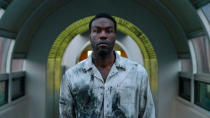 """Almost 30 years after Tony Todd's hook-wielding killer first appeared on the big screen, Nia DaCosta has directed this new take on the story, with Jordan Peele on board as a producer. Yahya Abdul-Mateen II plays a visual artist who ends up exploring the legend of the Candyman, with consequences which reverberate in his own life. <a href=""""https://uk.movies.yahoo.com/tony-todd-promises-that-the-new-candyman-will-deliver-091545414.html"""" data-ylk=""""slk:Todd is back in some form;outcm:mb_qualified_link;_E:mb_qualified_link;ct:story;"""" class=""""link rapid-noclick-resp yahoo-link"""">Todd is back in some form</a>, but the nature of his appearance remains shrouded in mystery. (Credit: Universal)"""