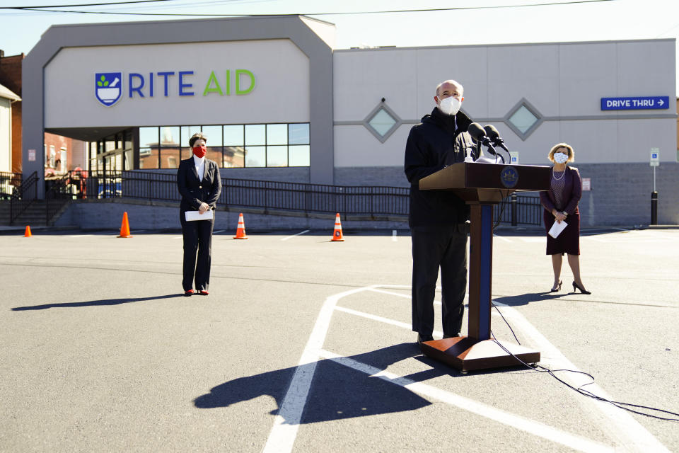 Pennsylvania, Gov. Tom Wolf, center, accompanied by, Department of Human Services Secretary Teresa Miller, left, and Rite-Aid Chief Pharmacy Officer Jocelyn Konrad, speaks outside a Rite-Aid pharmacy in Steelton, Pa., that is administering COVID-19 vaccinations, Friday, March 5, 2021. (AP Photo/Matt Rourke)