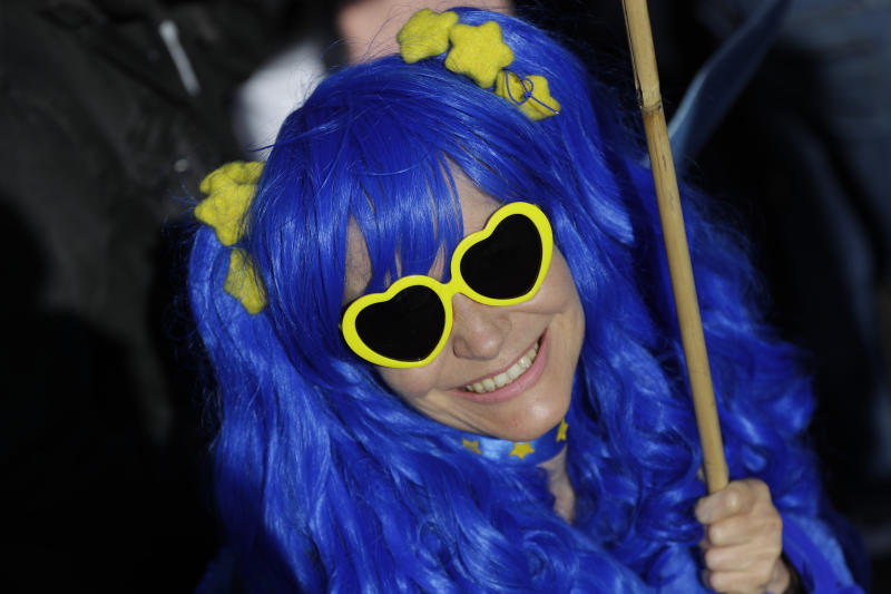 A woman wears the colors and stars of the EU flag as she and other anti-Brexit supporters march in London, Saturday, Oct. 19, 2019. In their first weekend session in 37 years, British lawmakers in Parliament debated whether to accept Prime Minister Boris Johnson's proposed new divorce deal with the European Union. (AP Photo/Kirsty Wigglesworth)