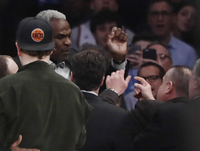 Former New York Knicks player Charles Oakley exchanges words with a security guard during the first half of an NBA basketball game between the New York Knicks and the LA Clippers Wednesday, Feb. 8, 2017, in New York. (AP Photo/Frank Franklin II)
