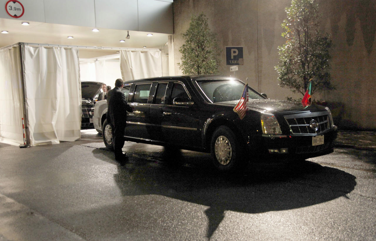 """One of U.S. President Barack Obama's limousine sits outside the President's hotel in Lisbon, Portugal, Friday, Nov. 19, 2010. Portuguese media seems fascinated by Obama's limousine, a sleek, armored car they've dubbed Cadillac One. Also known in Washington as """"The Beast"""", because of its extra-thick doors and huge tires, Noticias magazine called the limousine a """"bunker on wheels"""", and Sabado magazine calculated that the gas-guzzling Cadillac cost more than three times the Portuguese president's unarmored car. (AP Photo/Pablo Martinez Monsivais)"""
