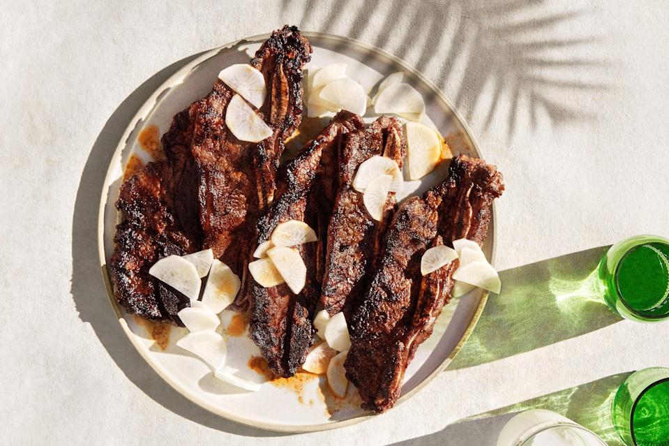 """If you've ever had kalbi at a Korean barbecue restaurant, you've had grilled flanken-style short ribs. Look for them prepackaged in the meat case, or ask your butcher. This concentrated, aromatic, spicy-sweet chile paste seasons the ribs robustly in as little as 15 minutes. <a href=""""https://www.epicurious.com/recipes/food/views/grilled-chile-lemongrass-beef-short-ribs-with-pickled-daikon?mbid=synd_yahoo_rss"""" rel=""""nofollow noopener"""" target=""""_blank"""" data-ylk=""""slk:See recipe."""" class=""""link rapid-noclick-resp"""">See recipe.</a>"""