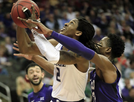 Kansas State guard Cartier Diarra (2) shoots as TCU guard RJ Nembhard, right, defends during the first half of an NCAA college basketball game in the quarterfinals of the Big 12 conference tournament in Kansas City, Mo., Thursday, March 14, 2019. (AP Photo/Orlin Wagner)