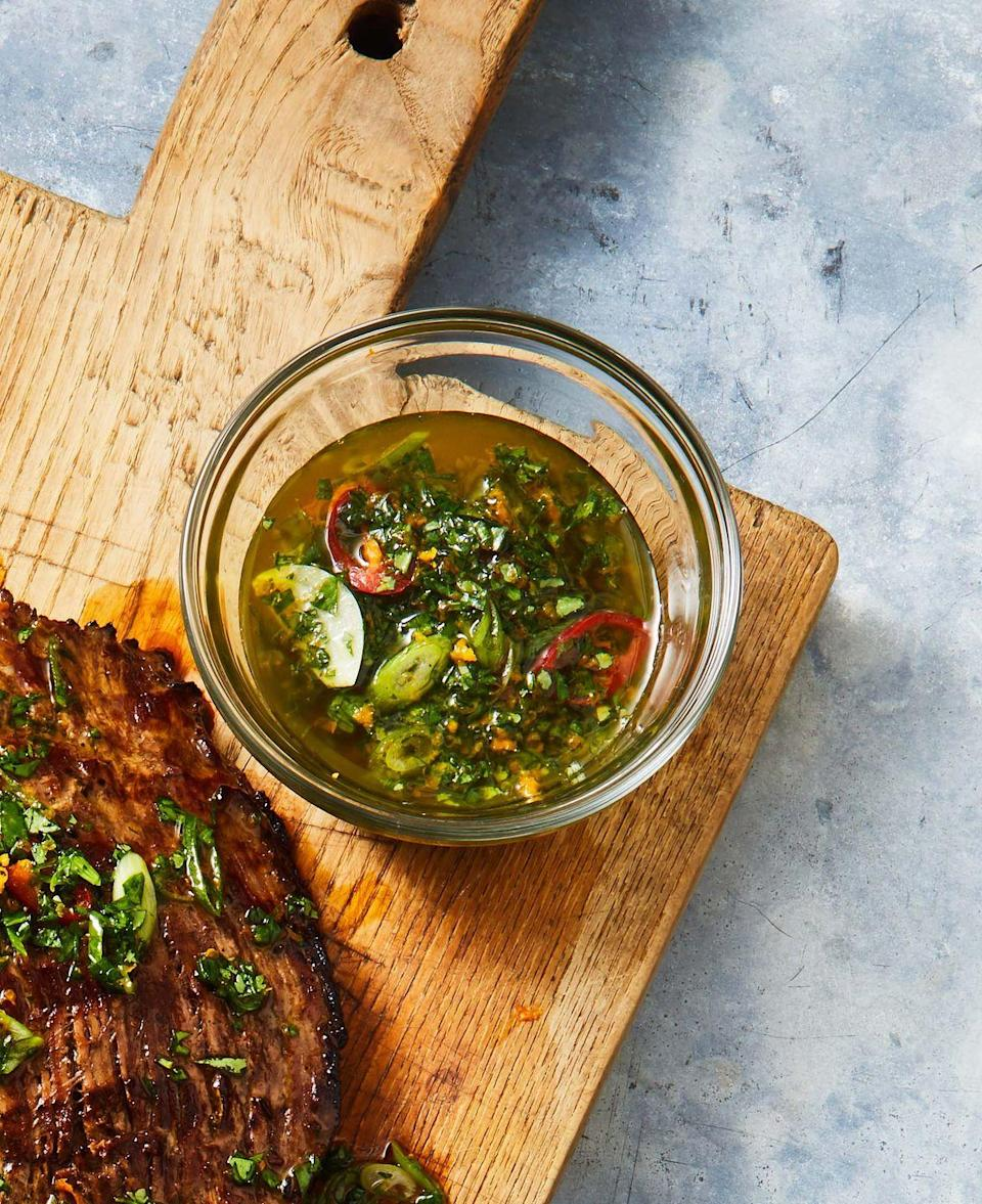 """<p>This spicy sauce can be used to marinate proteins too! Just double or triple the recipe so you have enough to cover the entire surface of the meat.</p><p><em><a href=""""https://www.goodhousekeeping.com/food-recipes/a36281224/orange-spiked-chimichurri-recipe/"""" rel=""""nofollow noopener"""" target=""""_blank"""" data-ylk=""""slk:Get the recipe for Orange-Spiked Chimichurri »"""" class=""""link rapid-noclick-resp"""">Get the recipe for Orange-Spiked Chimichurri »</a></em></p>"""