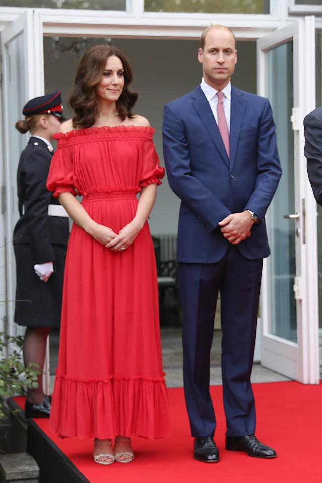 <p>The Duchess turned to Alexander McQueen for a garden party in Berlin, during the royal tour of Poland and Germany. <br /><em>[Photo: PA]</em> </p>
