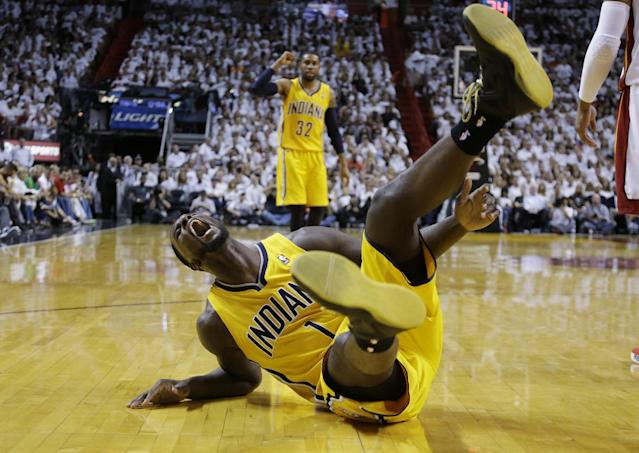 Indiana Pacers guard Lance Stephenson (1) yells after he fell hard following a foul from Miami Heat center Chris Bosh during the first half of Game 3 in the NBA basketball Eastern Conference finals playoff series, Saturday, May 24, 2014, in Miami. (AP Photo/Lynne Sladky)