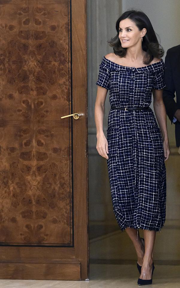 """<p>Queen Letizia looked like a million bucks wearing a <a href=""""https://www.zara.com/us/en/tweed-dress-with-gemstone-buttons-p03440048.html"""" target=""""_blank"""" class=""""ga-track"""" data-ga-category=""""Related"""" data-ga-label=""""https://www.zara.com/us/en/tweed-dress-with-gemstone-buttons-p03440048.html"""" data-ga-action=""""In-Line Links"""">$30 Zara dress</a> with a thin black belt and slingback pumps.</p>"""