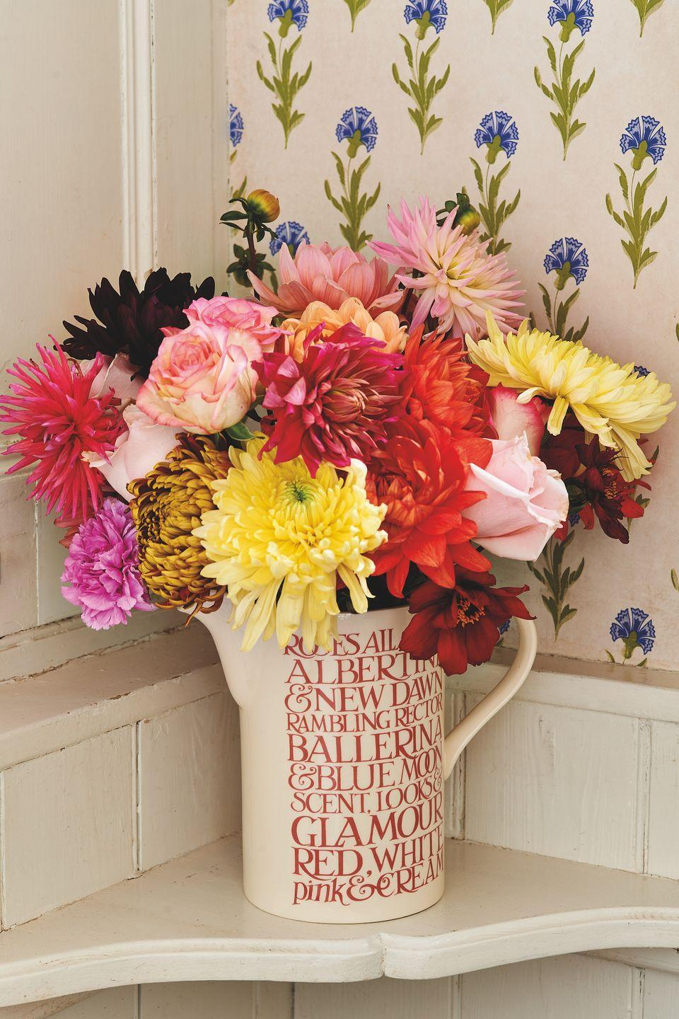 """<p>Show off your blooms with this breathtaking ceramic <a href=""""https://www.countryliving.com/uk/homes-interiors/gardens/g35147195/flower-trends-2021/"""" rel=""""nofollow noopener"""" target=""""_blank"""" data-ylk=""""slk:flower"""" class=""""link rapid-noclick-resp"""">flower</a> vase. As part of the 'Pink Toast' range, it celebrates the beauty of our favourite flowers. </p><p><a class=""""link rapid-noclick-resp"""" href=""""https://go.redirectingat.com?id=127X1599956&url=https%3A%2F%2Fwww.emmabridgewater.co.uk%2Fproducts%2Fpink-toast-roses-all-my-life-tall-straight-jug&sref=https%3A%2F%2Fwww.countryliving.com%2Fuk%2Fhomes-interiors%2Finteriors%2Fg35249240%2Femma-bridgewater-spring%2F"""" rel=""""nofollow noopener"""" target=""""_blank"""" data-ylk=""""slk:BUY NOW, £65.95"""">BUY NOW, £65.95</a> </p>"""