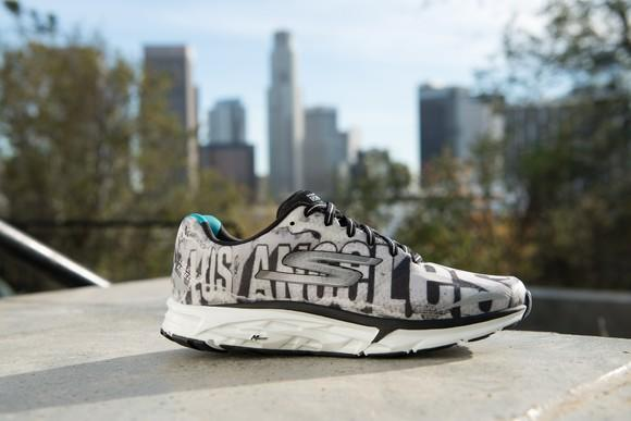 A Skechers shoe with distant buildings behind it