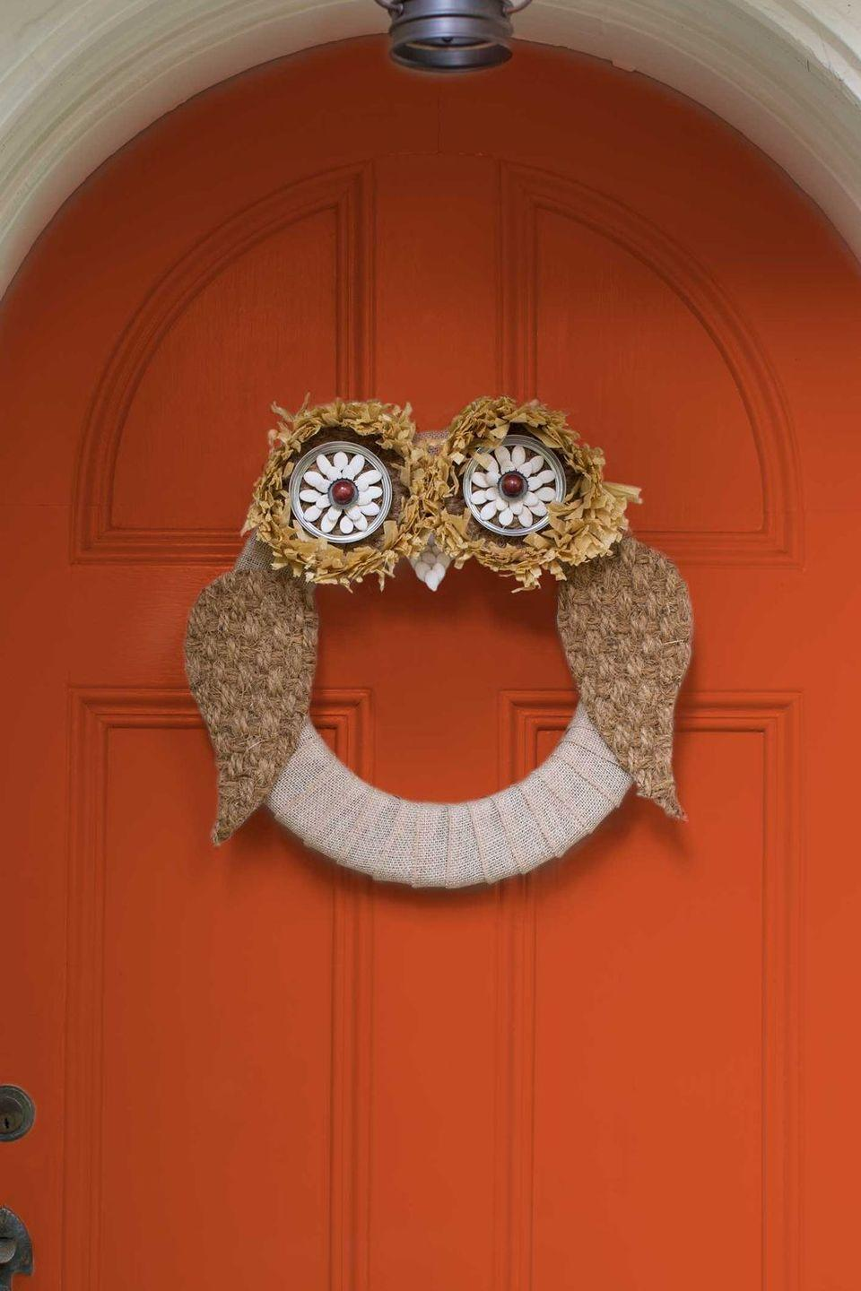 """<p>Fashion this owl wreath for an adorable fall entrance. Your neighbors will think it's a hoot! <strong><br></strong></p><p><strong>Make the wreath</strong>: Wrap <a href=""""https://www.amazon.com/Creative-Burlap-Fabric-Craft-Ribbon/dp/B0046UV3CO/?linkCode=ogi&tag=syn-yahoo-20&ascsubtag=%5Bartid%7C10050.g.2610%5Bsrc%7Cyahoo-us"""" rel=""""nofollow noopener"""" target=""""_blank"""" data-ylk=""""slk:burlap ribbon"""" class=""""link rapid-noclick-resp"""">burlap ribbon</a> around a <a href=""""https://www.amazon.com/Floracraft-FLOXT12WU-Styrofoam-Extruded-Wreath/dp/B002V3ENOS/?linkCode=ogi&tag=syn-yahoo-20&ascsubtag=%5Bartid%7C10050.g.2610%5Bsrc%7Cyahoo-us"""" rel=""""nofollow noopener"""" target=""""_blank"""" data-ylk=""""slk:12&quot; Styrofoam form"""" class=""""link rapid-noclick-resp"""">12"""" Styrofoam form</a>. For the eyes, use utility scissors to cut a 5"""" circle from a <a href=""""https://www.amazon.com/Kempf-Natural-Coco-Doormat-1-Inch/dp/B004EBHSI8?linkCode=ogi&tag=syn-yahoo-20&ascsubtag=%5Bartid%7C10050.g.2610%5Bsrc%7Cyahoo-us"""" rel=""""nofollow noopener"""" target=""""_blank"""" data-ylk=""""slk:sisal doormat"""" class=""""link rapid-noclick-resp"""">sisal doormat</a>. Trim a 2"""" strip from the edge of a <a href=""""https://www.amazon.com/Raffia-Table-Skirting-Party-Decoration/dp/B000RHLLS6?linkCode=ogi&tag=syn-yahoo-20&ascsubtag=%5Bartid%7C10050.g.2610%5Bsrc%7Cyahoo-us"""" rel=""""nofollow noopener"""" target=""""_blank"""" data-ylk=""""slk:raffia table skirt"""" class=""""link rapid-noclick-resp"""">raffia table skirt</a> and hot-glue along the outer edge.Next, hot-glue the outer ring of a 41/2""""-inch <a href=""""https://www.amazon.com/KooK-Mason-Regular-Secure-Silver/dp/B079F511CS/?linkCode=ogi&tag=syn-yahoo-20&ascsubtag=%5Bartid%7C10050.g.2610%5Bsrc%7Cyahoo-us"""" rel=""""nofollow noopener"""" target=""""_blank"""" data-ylk=""""slk:Mason jar lid"""" class=""""link rapid-noclick-resp"""">Mason jar lid</a> inside the raffia, securing it to the sisal circle. Hot-glue a metal bottle cap at the center of the ring and encircle with dried pumpkin seeds. Hot-glue a <a href=""""https://www.amazon.com/Assorted-"""