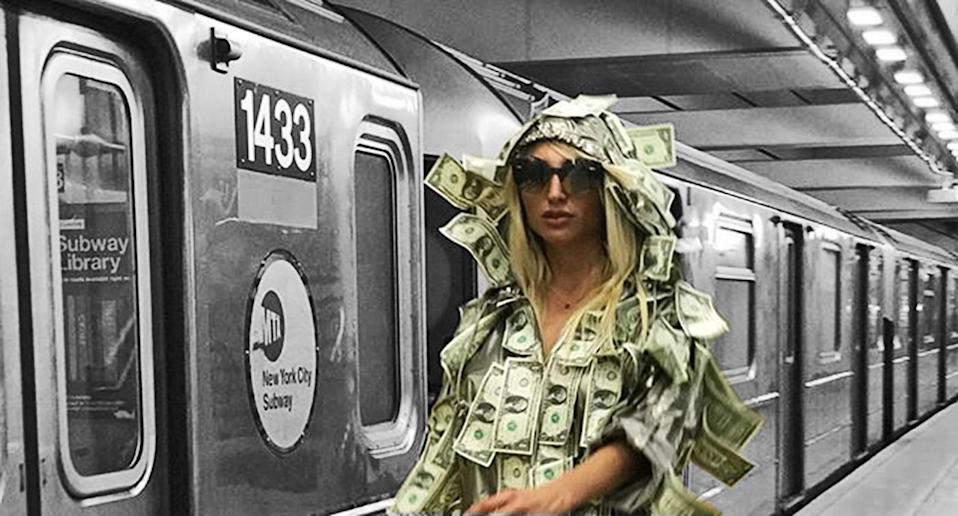 Argentine model Victoria Xipolitakis strolled the NYC subways covered in money that she was giving away.
