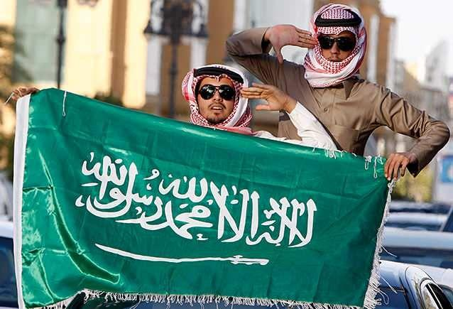 """Image 3: The Saudi Arabia flag, which says """"There is no God but Allah, and Muhammad is his messenger"""". Photo: AP"""