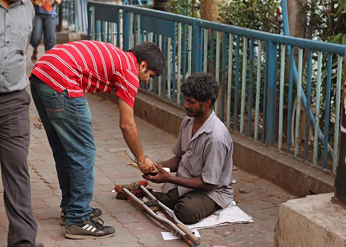 When everyone was busy with their lives and passing by, this guy stopped to give this disabled man his sandwich.