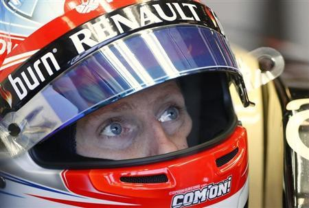 Lotus Formula One driver Grosjean of France looks up during the first practice session of the Australian F1 Grand Prix in Melbourne