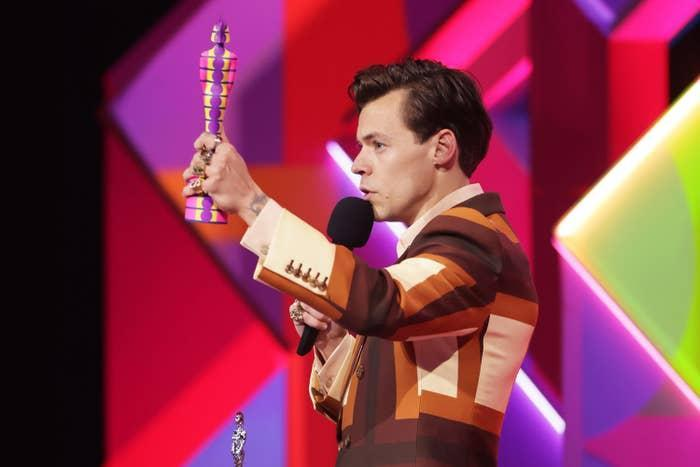 Harry Styles accepts an award onstage at the BRIT Awards in 2021