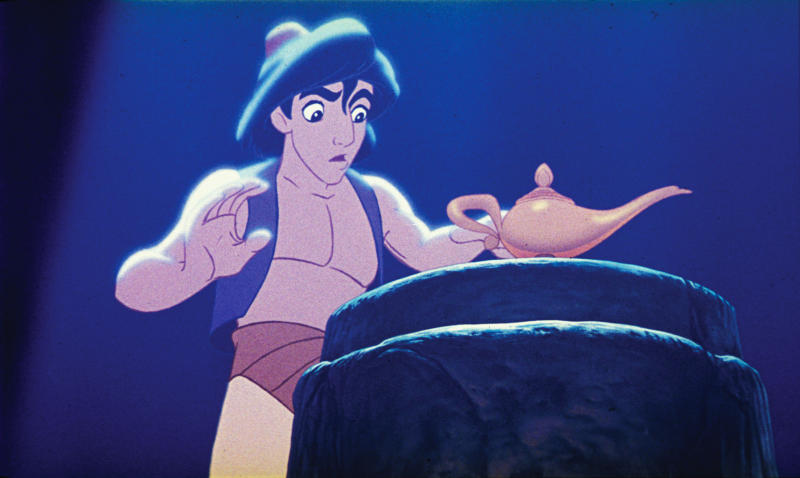 "This undated publicity photo provided by Disney Theatrical Productions shows Aladdin with a lamp in a scene from the 1992 animated film, ""Aladdin."" A stage musical of ""Aladdin"" is riding a magic carpet to Broadway and the president of Disney Theatrical Productions promises it will be ""a full-length, big song musical with big dance numbers.""  Thomas Schumacher said on Friday, Jan. 18, 2013, that the final two-act ""Aladdin"" will build on the 1992 film blockbuster with new songs by Alan Menken, additional characters and, appropriately, some magic tricks. (AP Photo/Disney Theatrical Productions)"