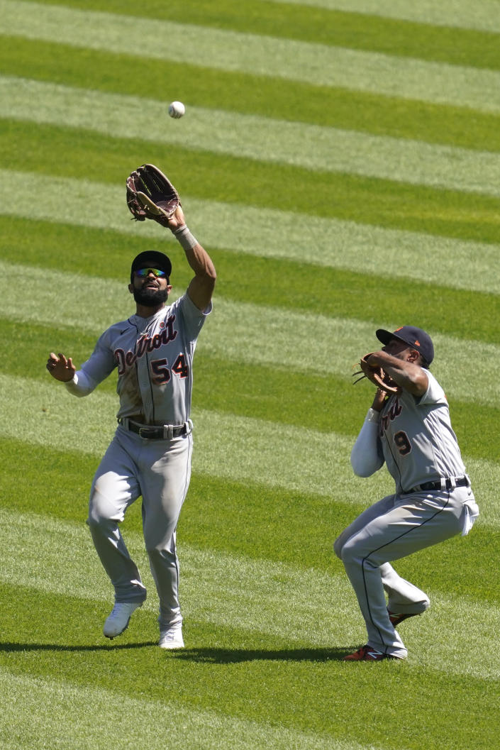 Detroit Tigers center fielder Derek Hill, left, catches a fly ball hit by Chicago White Sox's Jose Abreu as Detroit Tigers shortstop Willi Castro, right, watches during the fifth inning of a baseball game in Chicago, Saturday, June 5, 2021. (AP Photo/Nam Y. Huh)