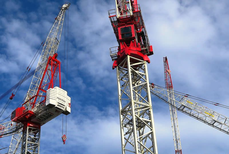 A sign for Fletcher Building Ltd, New Zealand's biggest builder, adorns a crane at a construction site in the New Zealand city of Auckland