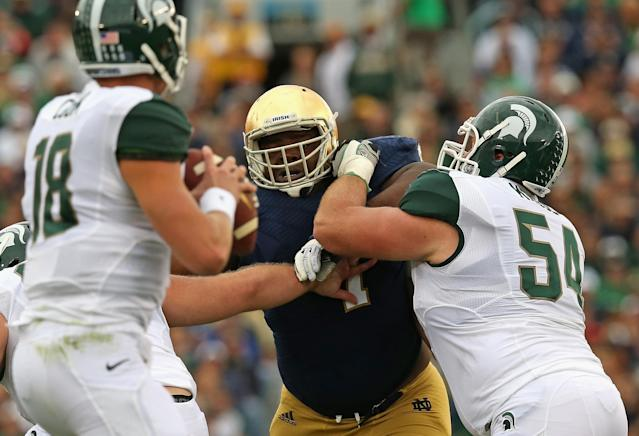 SOUTH BEND, IN - SEPTEMBER 21: Louis Nix III #1 of the Notre Dame Fighting Irish rushes against Connor Kruse #54 of the Michigan State Spartans at Notre Dame Stadium on September 21, 2013 in South Bend, Indiana. Notre Dame defeated Michigan State 17-13. (Photo by Jonathan Daniel/Getty Images)