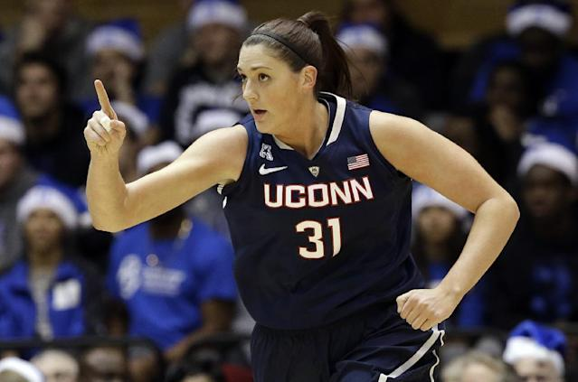 Connecticut's Stefanie Dolson (31) reacts following her basket against Duke during the first half of an NCAA college basketball game in Durham, N.C., Tuesday, Dec. 17, 2013. Connecticut won 83-61. (AP Photo/Gerry Broome)