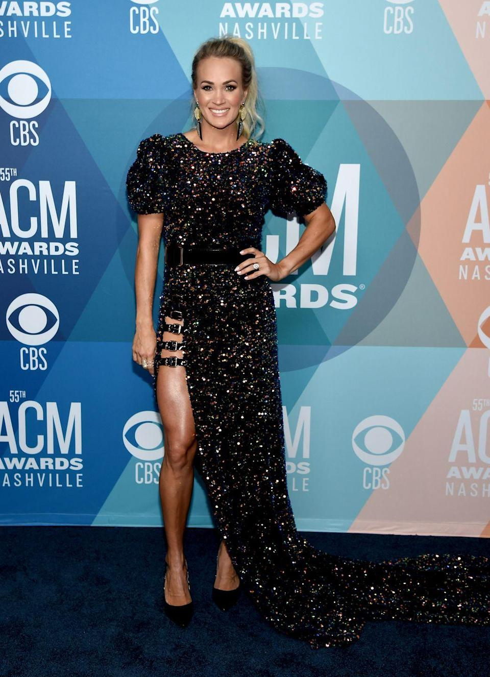 <p><strong>16 September</strong> Carrie Underwood wore a glittering dress with a dramatic thigh-high split.</p>