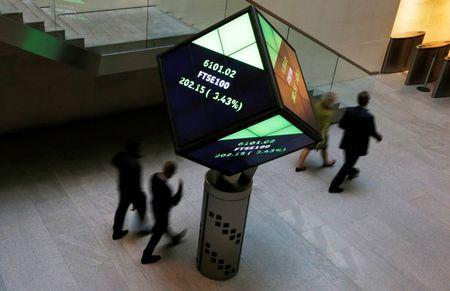People walk through the lobby of the London Stock Exchange in London, Britain August 25, 2015. REUTERS/Suzanne Plunkett -