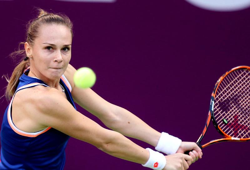 Magdalena Rybarikova of Slovakia returns the ball to Francesca Schiavone of Italy during the second day of the WTA Qatar Ladies Open in Doha, Qatar, Tuesday, Feb. 11, 2014. (AP Photo/Osama Faisal)